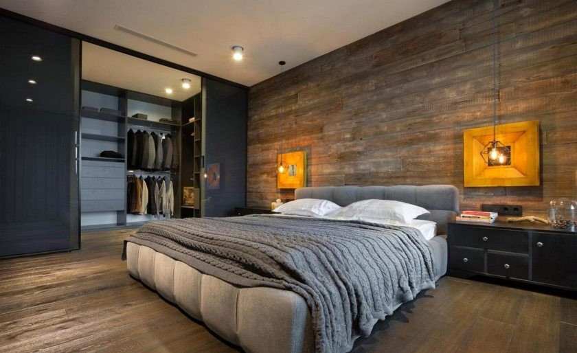 Une idée pour décorer une chambre de couleur bleu foncé et avec des éléments en bois