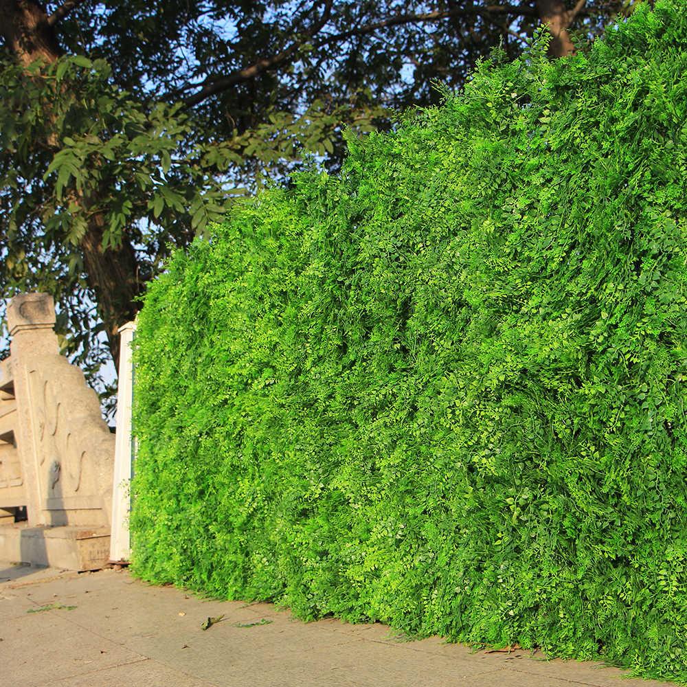 La décoration pour les murs extérieurs d'une maison - un mur d'arbustes