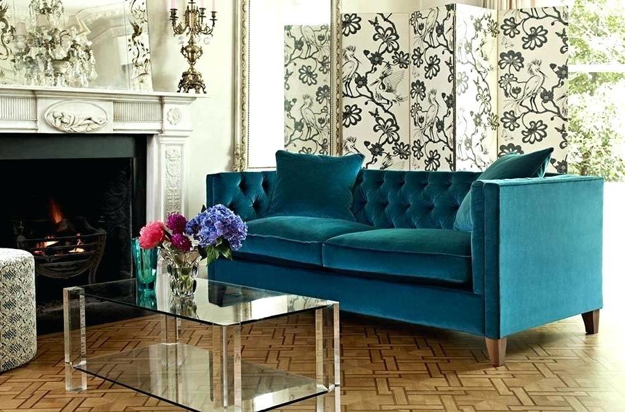 Canapé velours bleu pétrole - pure élégance.