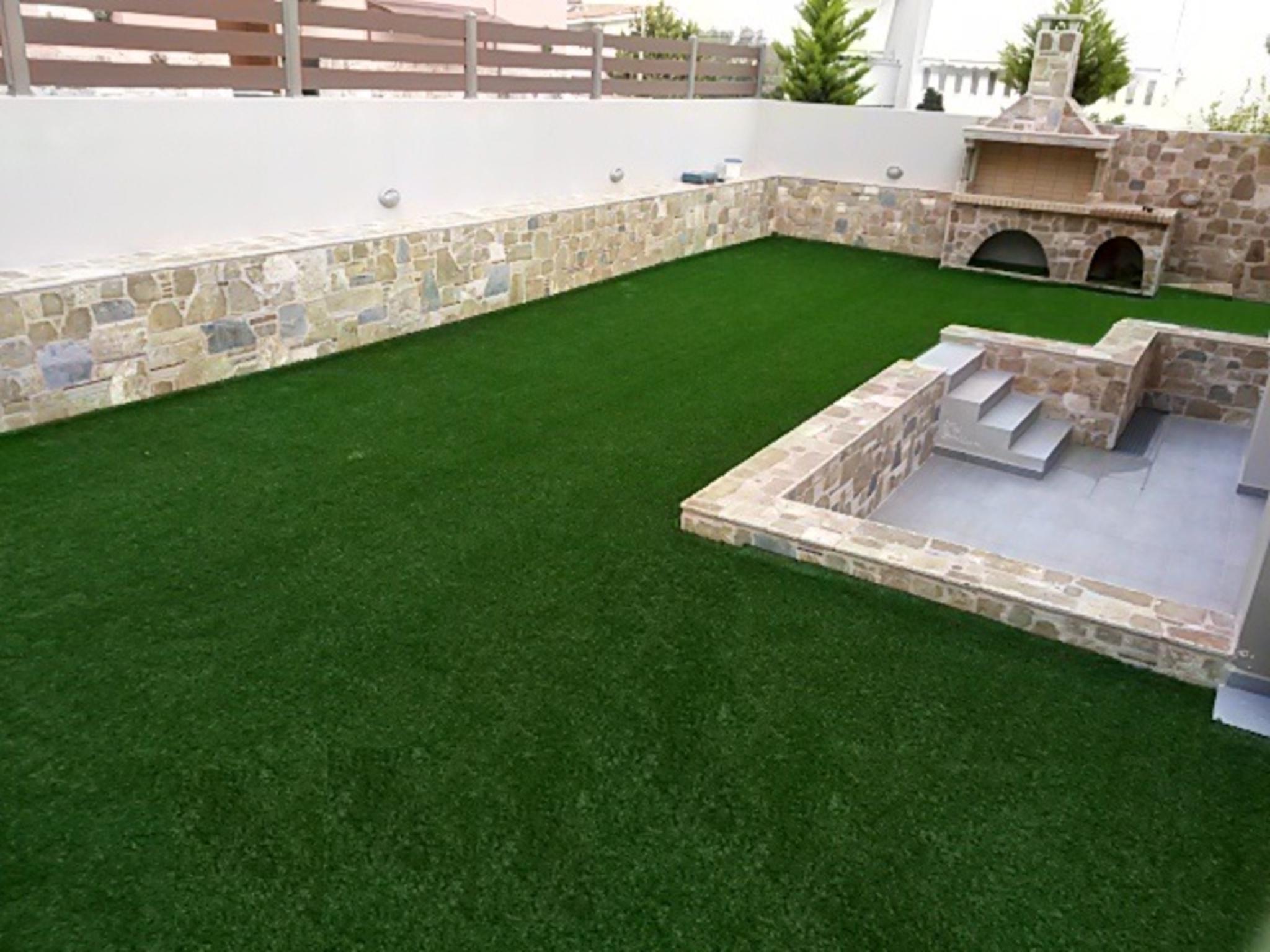 Idée de déco de jardin avec un barbecue de pierrese barbecue