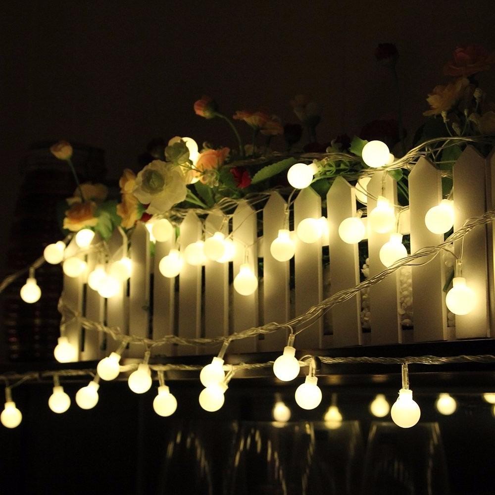 Idée pour déco la clôture de jardin avec des lumières
