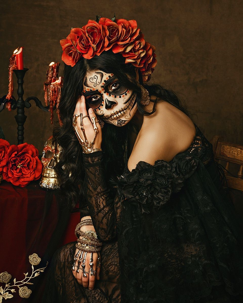 A girl with a pretty skull makeup.