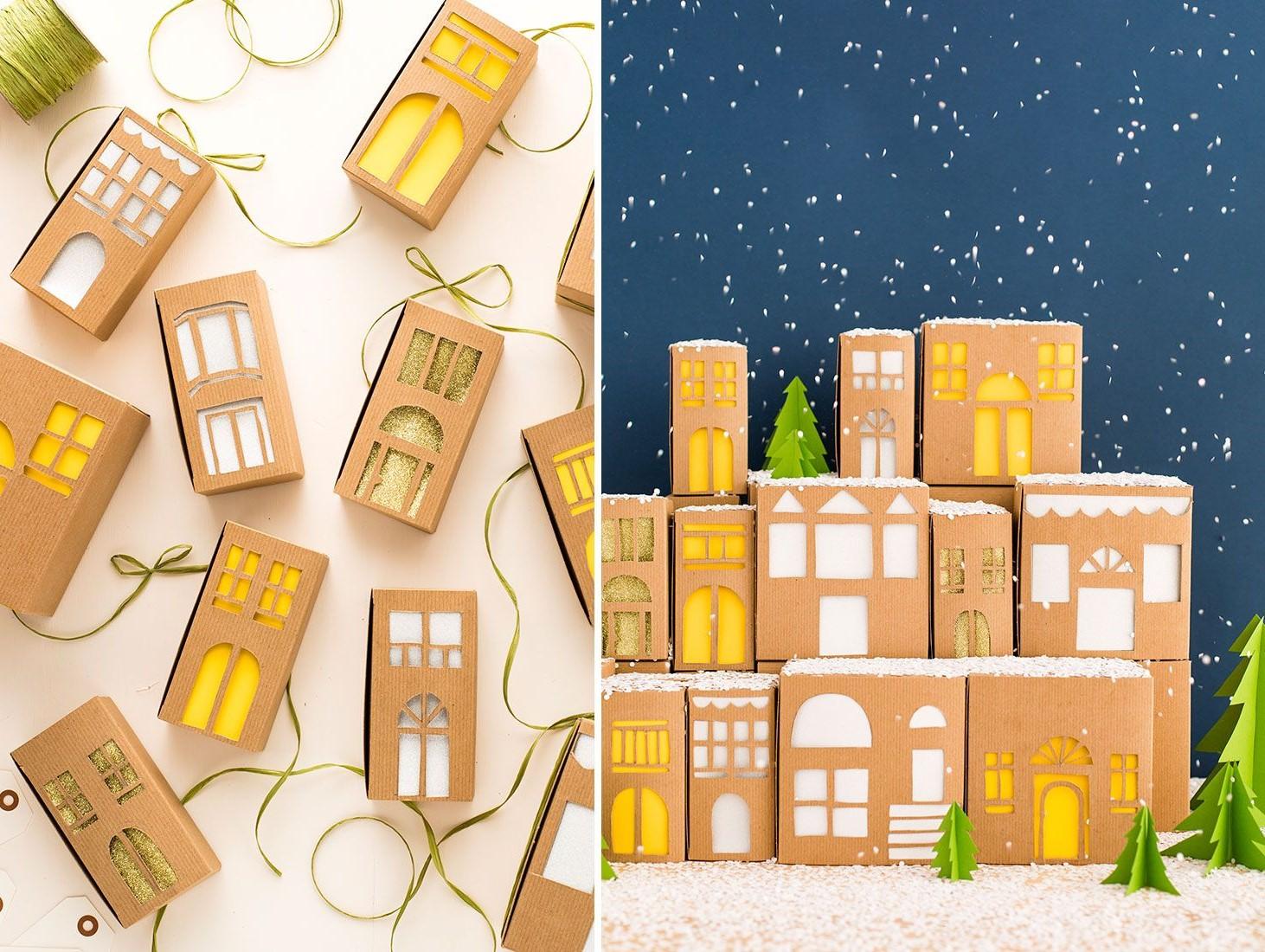Ville de Noël avec des maisons faites de boîtes en carton.