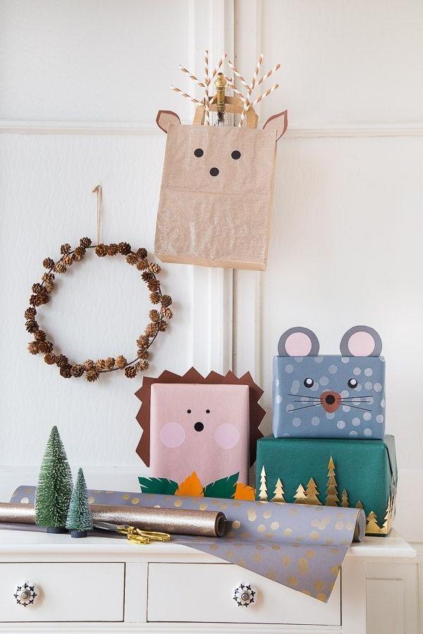 Boîte en carton de Noël décorée avec des animaux en papier.
