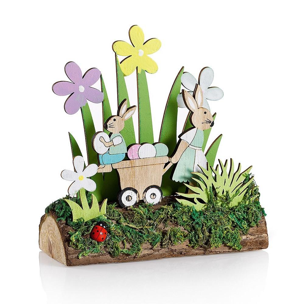 Décoration de printemps avec des lapins en bois.