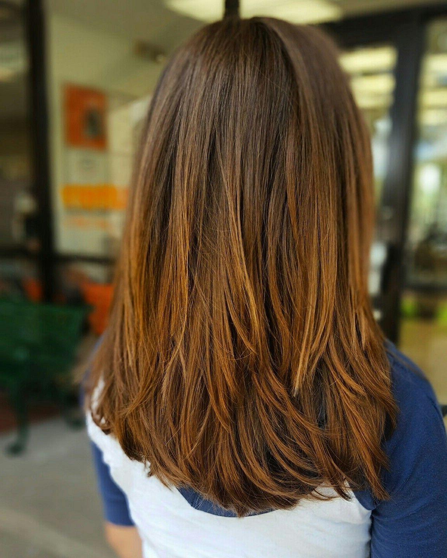Coupe dégradée sur cheveux longs.