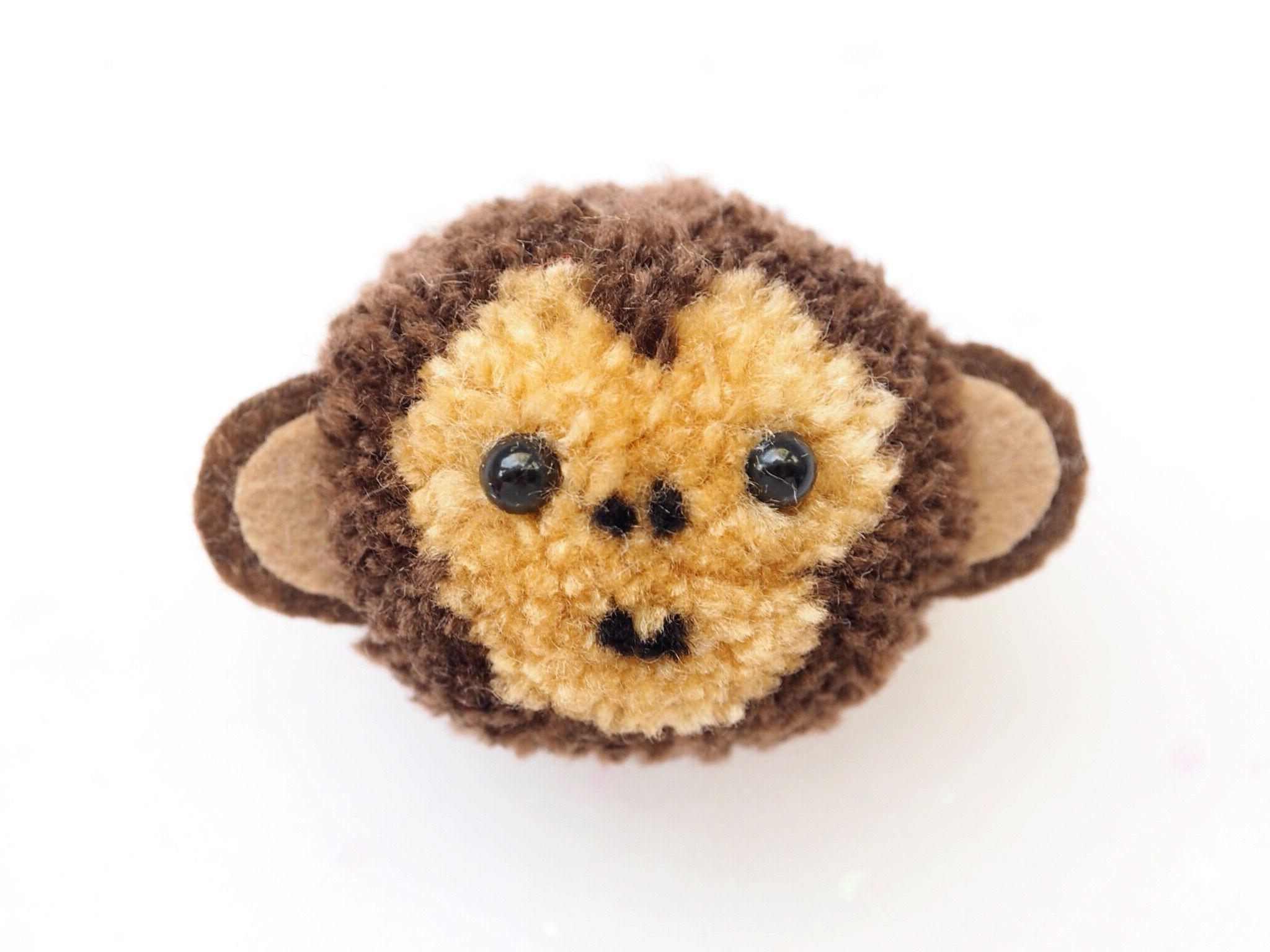 Animaux en pompons: singe moelleux.