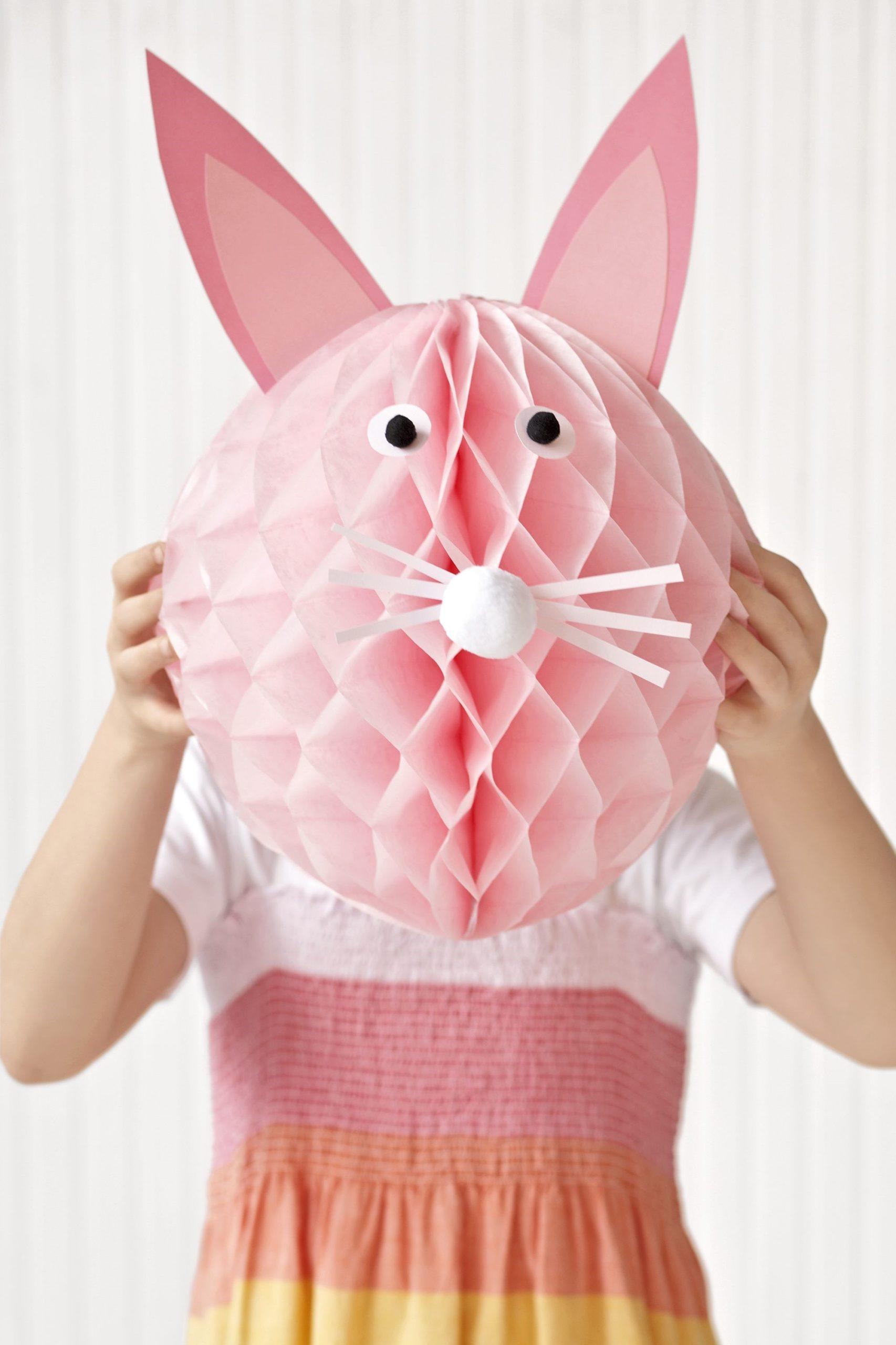 Décoration en forme de lapin de Pâques rose pour votre fête.
