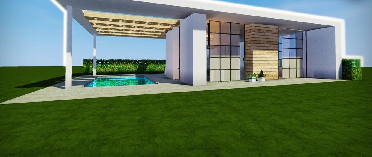 Grande maison moderne avec piscine intérieure dans un minecraft