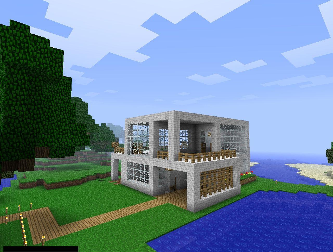 Maison de laine au bord du lac dans un minecraft