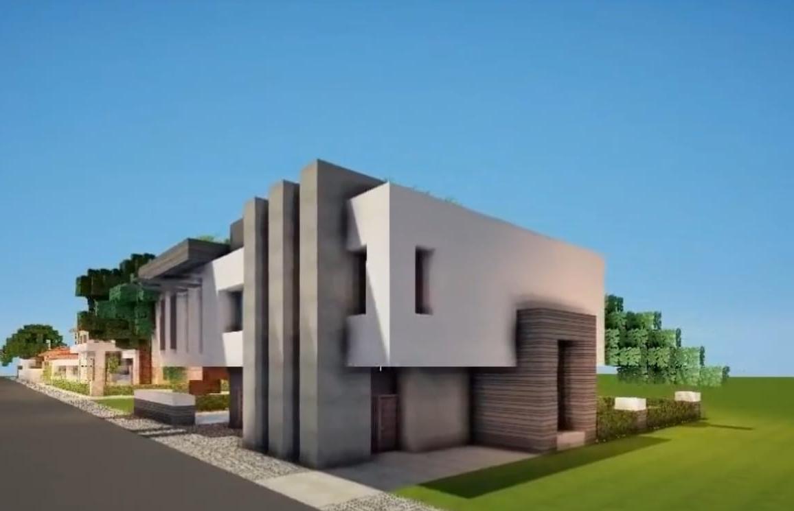 Maison moderne avec jardin dans un minecraft