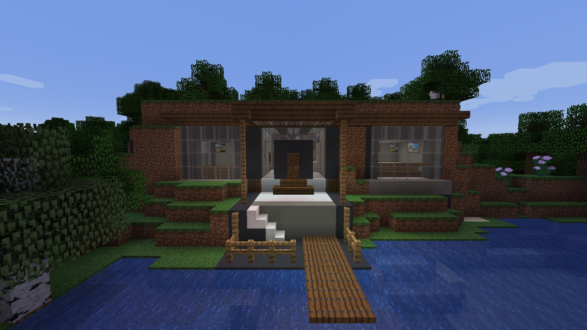 Maison moderne dans la montagne sur une jetée avec un quai dans un minecraft