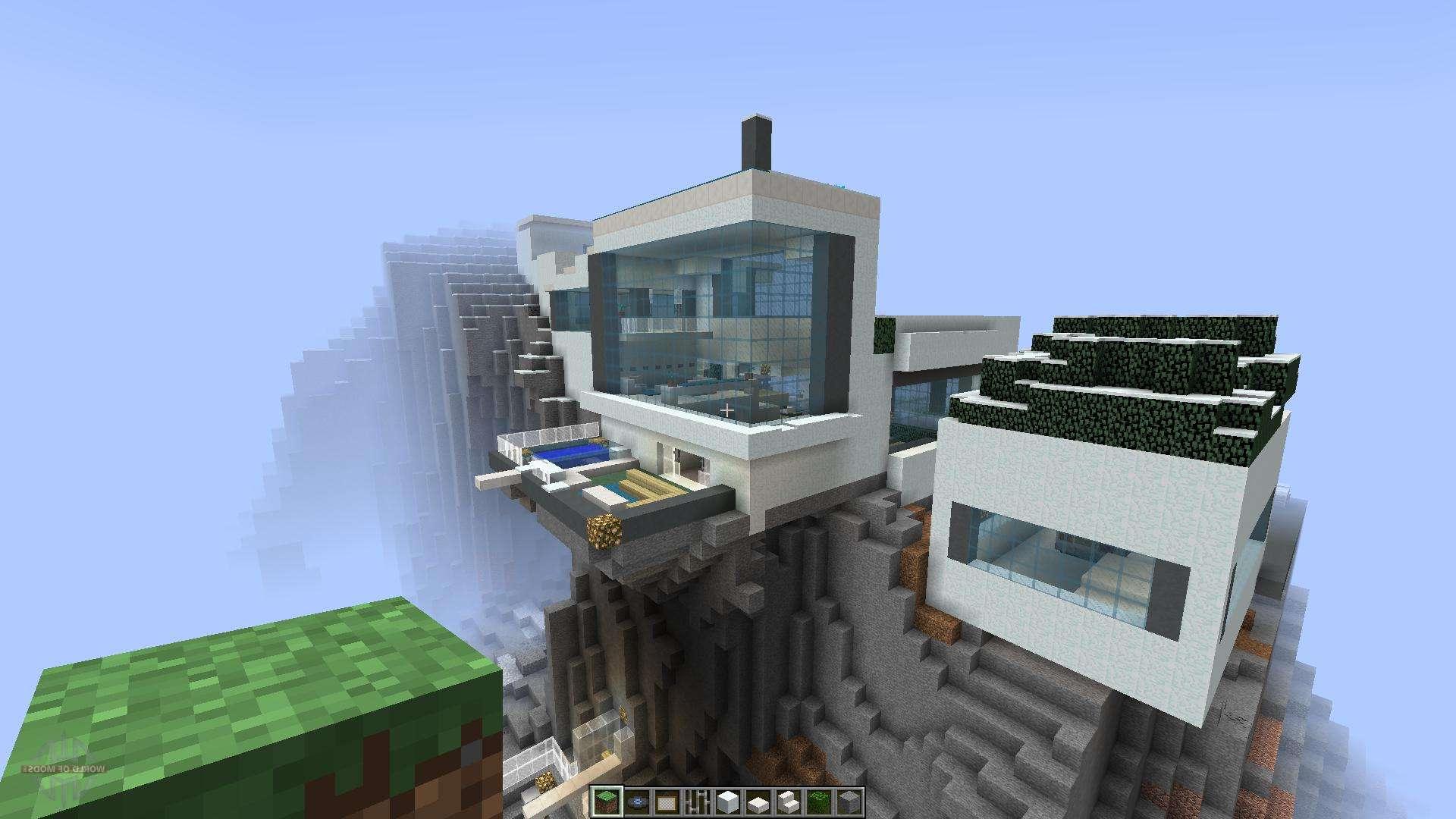 Maison moderne dans la montagne de la neige dans le minecraft