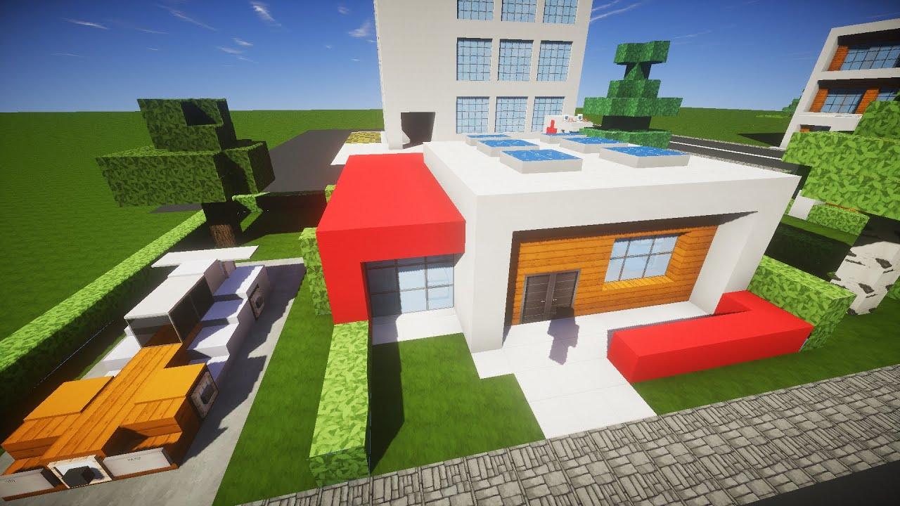 Maison moderne dans un minecraft avec une voiture de sport
